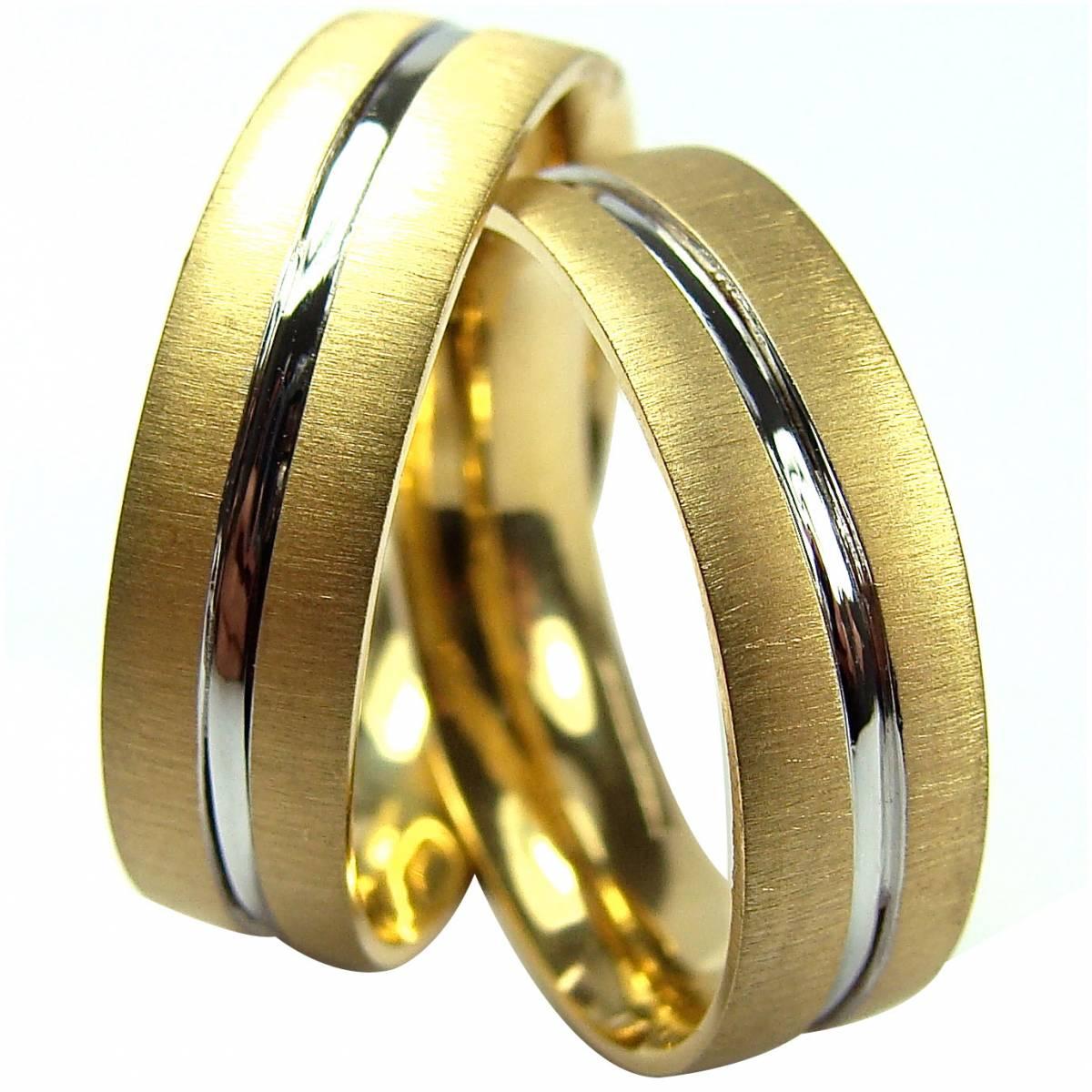 Alianças de ouro bicolor em ouro de 9 e 19,2 kts. Largura: 6,5 mm