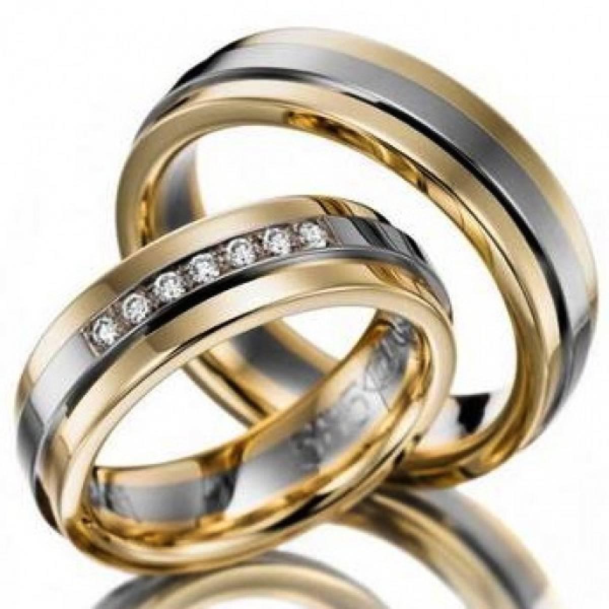 Alianças de Casamento em Ouro Bicolores com 7 Diamantes de 0,11 CTS